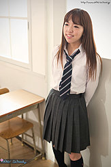 Student In Classroom Wearing Uniform Long Hair Falling Over Her Shirt In Pleated Skirt