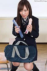 Student Seated In Classroom Wearing Uniform Holding Sex Toys
