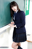 Standing beside blackboard in uniform