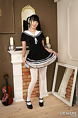 Lifting Hem Of Dress In White Stockings And Black High Heels