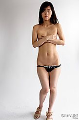 Standing In Heels Arms Folded Covering Small Tits Knickers Pulled Down Over Bare Pussy