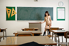 Teen Japanese Girl Mana Aoki Strips Kogal Uniform In Classroom Standing Nude Her Hair In Pigtails Sweet Small Breasts Revealed Natural Bush Between Slightly Parted Thighs Desks And Blackboard In Class
