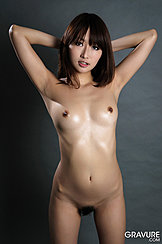 Mana Aoki With Her Arms Raised Behind Her Head Long Hair To Her Shoulders Small Breasts Trimmed Bush Between Her Parted Thighs