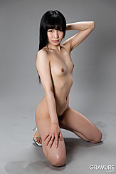 Kneeling Nude On Floor Arm Raised Behind Her Head Small Breasts Hand On Thigh