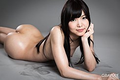 Shino Aoi Lying On Her Front Face Propped Up On Her Have Nice Ass