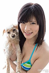 Holding Dog Wearing Bikini Top