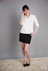 Office Lady Wearing White Shirt In Short Black Skirt Wearing High Heels Adjusting Her Glasses
