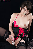 Seated in lingerie breast exposed masturbating with vibrator