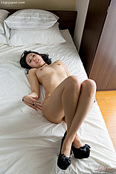 On Bed Naked Legs Crossed Bare Breasts In Black High Heels