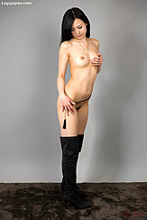 Standing Naked In Black Knee High Boots Hand Cupping Her Left Breast Hand On Her Thigh