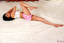 Raising Her Right Legs Her Feet Are Bare In Tight Pink Panties