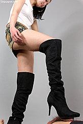Giving Footjob Wearing Black High Heeled Boots In Tshirt And Denim Skirt