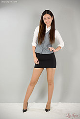 Office Lady Standing With Hand On Hip Long Hair Short Skirt Wearing Pantyhose In High Heels