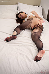 Lying On Bed Top Pulled Up Over Her Tits Masturbating In Ripped Pantyhose