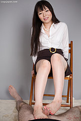 Giving Footjob With Her Bare Feet Sitting On Chair Long Hair White Shirt