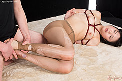 Arms Tied Behind Her Back In Ripped Pantyhose Man Rubbing His Cock Between Her Feet