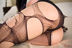 Saionji Reo Lying On Her Side In Torn Pantyhose