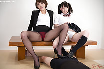 Tutor Mai Miori teaches student Yui Kasugano how to give footjob