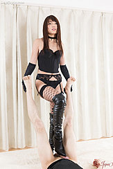 Standing Over Man In Basque Fishnet Stockings Rubbing His Cock With Her Black Boots