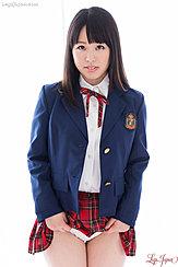 Student In Uniform Raising Hem Of Plaid Skirt Exposing Her Panties