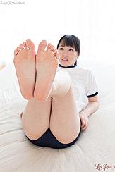 Reclining In Gym Class Uniform Bare Feet Raised