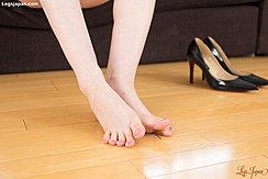 Bare Feet On Wooden Floor Painted Toenails