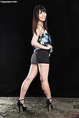 Looking Over Her Shoulder Long Hair Wearing Short Skirt In High Heels