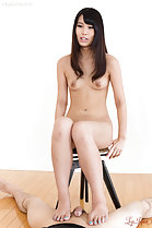Sitting on stool naked long hair bare feet