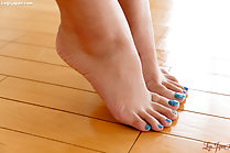 Kotomi Shinosaki pressing her bare feet together toenails painted blue