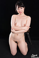 Kneeling Naked Arms Folded Under Her Bare Breasts