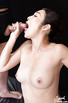 Enami Ryu giving handjob cock at her open mouth