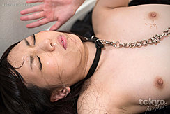 Yada Chiemi Lying On Her Back Naked Cum Glistening On Her Face Bondage Chain Falling Between Her Small Breasts