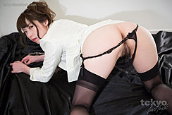 On All Fours Looking Over Her Shoulder Panties Pulled Down In Black Stockings