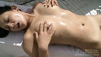 Chiharu rubbing cum into her bare breasts