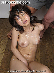 Nene Seated On Wooden Floor Hand Between Her Legs Face And Breasts Covered With Bukkake Cum