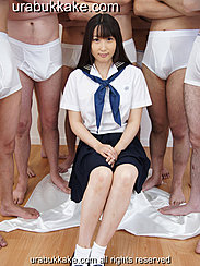 Kogal Seated In Front Of Half Naked Men Wearing Seifuku Hands Clasped On Her Lap