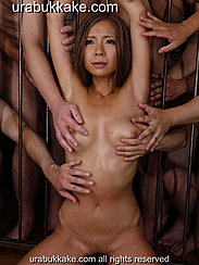 Men Reaching Through Bars To Fondle Her Breasts