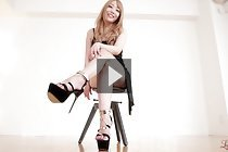 Blonde Mashiro Airi in evening dress and heels giving footjob